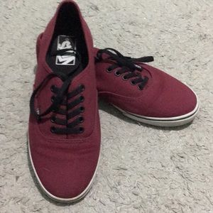 Red and black laced vans